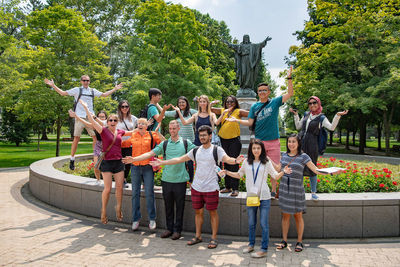 New students pose on God Quad during Graduate Student Orientation
