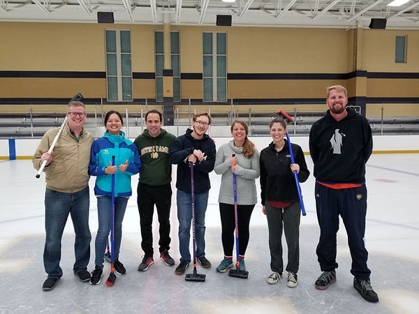 Associate Dean John Lubker joins LASER participants for a curling-themed team-building event