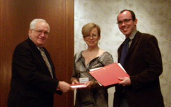 Julia Douthwaite and Daniel Richter, receiving their award from UCLA professor Frederick Burwick
