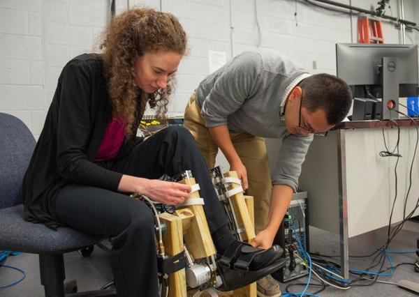 Anne Martin, '14 Ph.D., works to optimize exoskeleton support for walking assistance.
